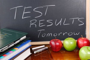 Message on blackboard of test results coming tomorrow